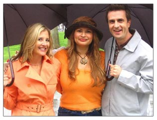 Shirley and hosts Christine Blackburn and Dan Sachoff get caught in the rain in Venice, California.
